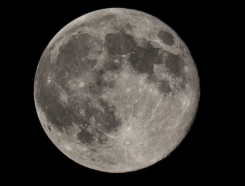 The moon is slowly pulling away from the earth